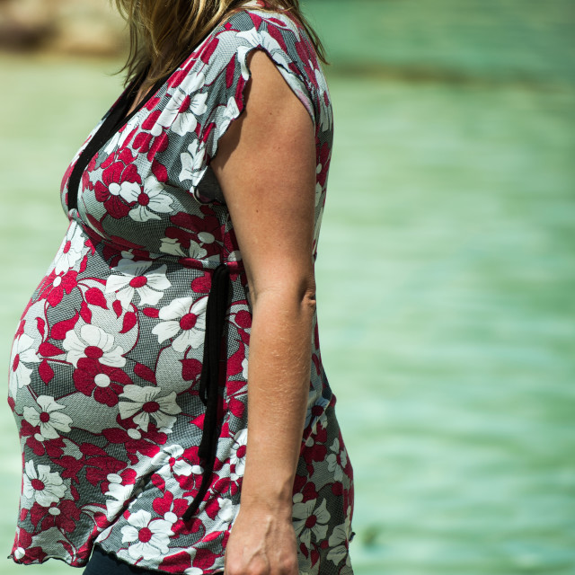"""Pregnant. A day at the beach"" stock image"
