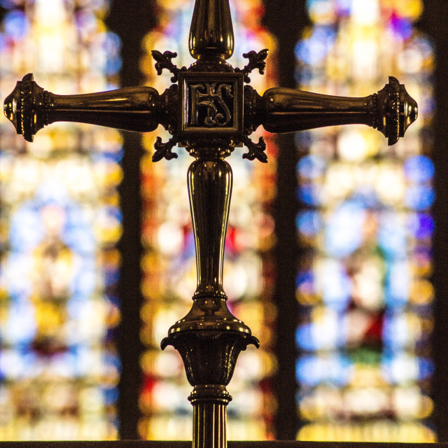 """Crucifix agaisnt Stained Glass Window"" stock image"