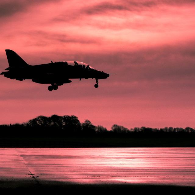 """Red Arrows sunset landing"" stock image"