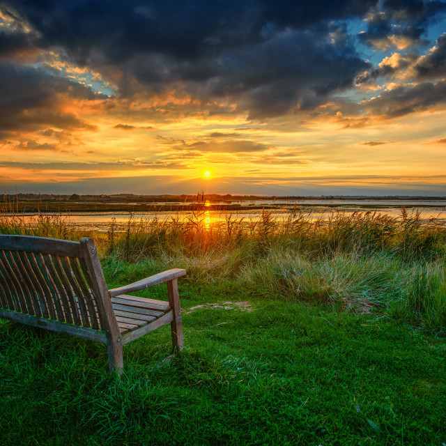 """Sit and Reflect As The Sun Goes Down"" stock image"