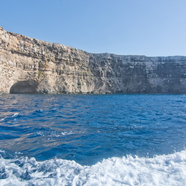 """""""Limestone rock with caves"""" stock image"""