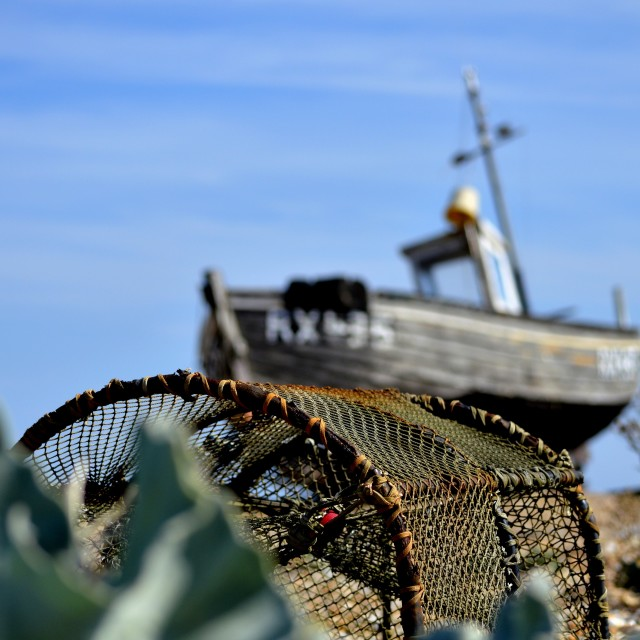 """A lobster pot and fishing boat"" stock image"