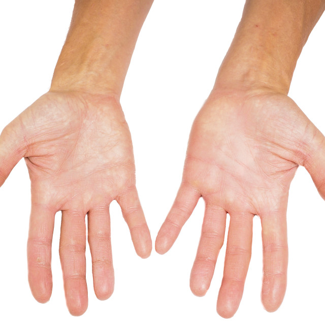 """Hands of a male person with fingers spread isolated towards white"" stock image"