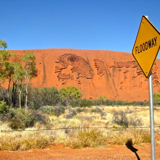 """Ayers Rock, Uluru signboard floodway"" stock image"