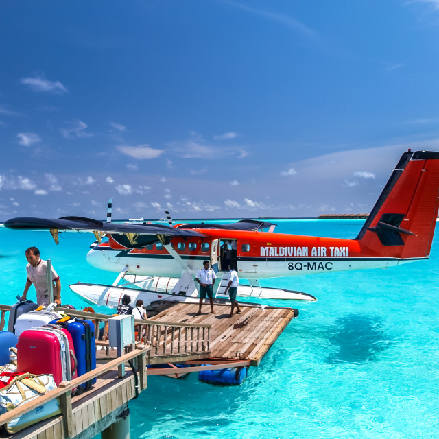 """air taxi landed close to one of maldives islands"" stock image"