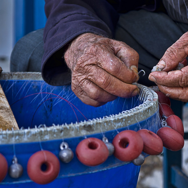 """Fisherman cretan of Loutro trigger hooks of a crow's nest"" stock image"