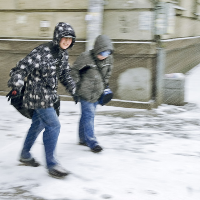 """boys in heavy snowstorm"" stock image"