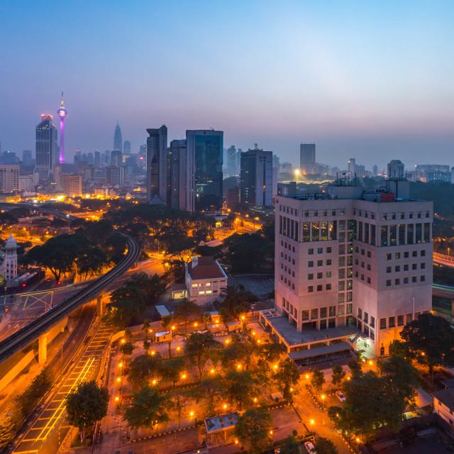 """""""Kuala Lumpur city skyline during sunrise blue hour"""" stock image"""