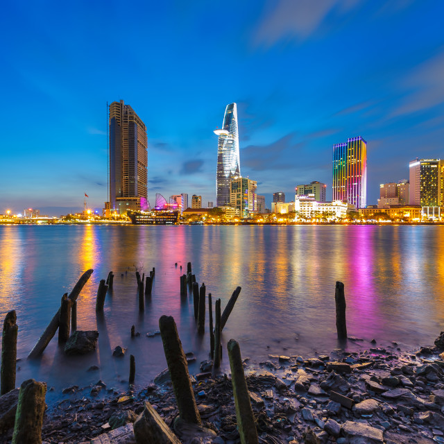 """Cityscape of Saigon river at downtown of Ho Chi Minh city, Vietnam in sunset"" stock image"