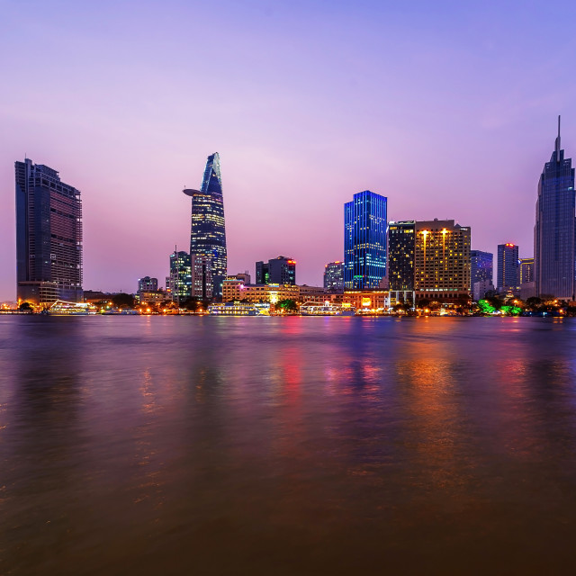 """""""Cityscape of Saigon river at downtown of Ho Chi Minh city, Vietnam in sunset"""" stock image"""