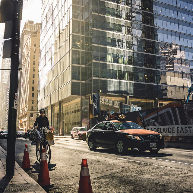 """Toronto riding the bike"" stock image"
