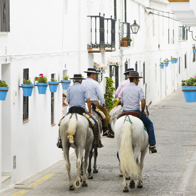 """Men on horses in andalusian village"" stock image"