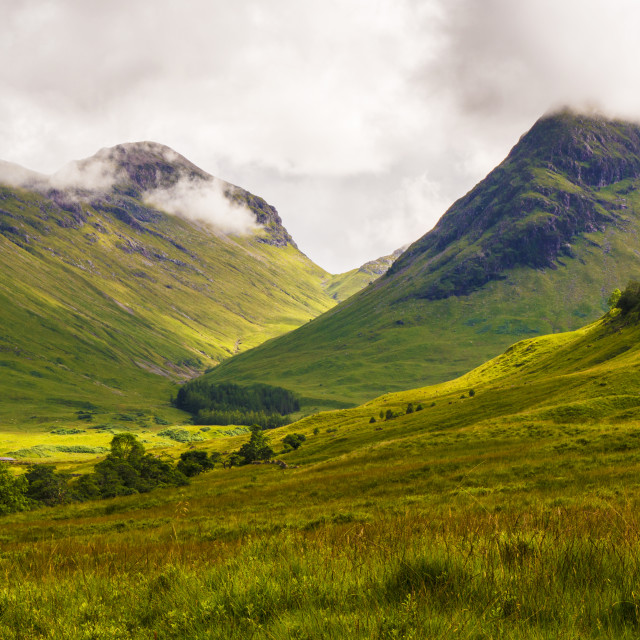 """""""The Mountains of Glencoe topped with cloud."""" stock image"""