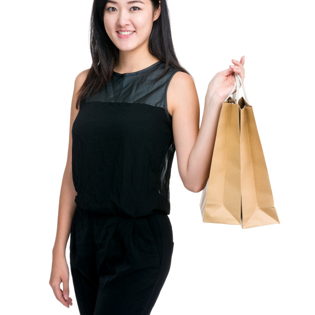 """Young girl hold shopping bag"" stock image"