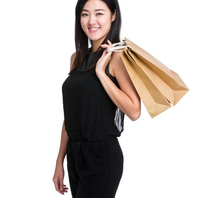 """Asian woman with shopping bag"" stock image"