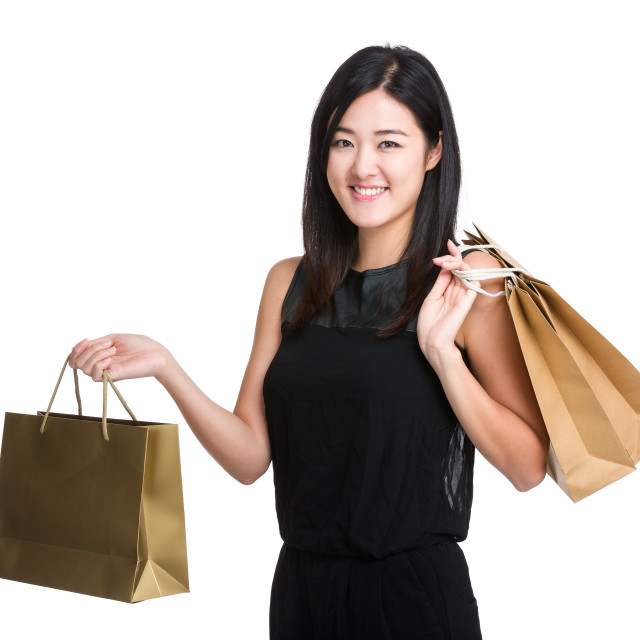 """Happy woman with shopping bag"" stock image"