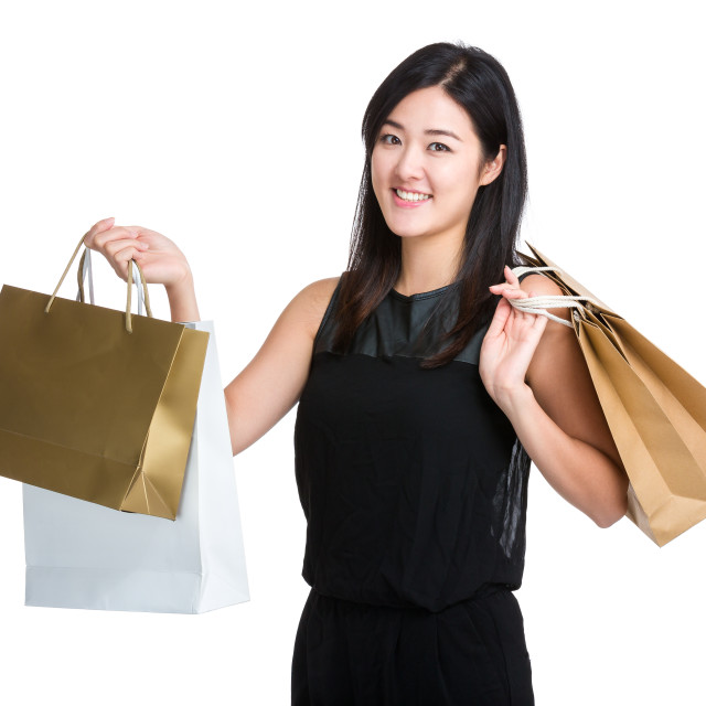 """Woman with shopping bag"" stock image"