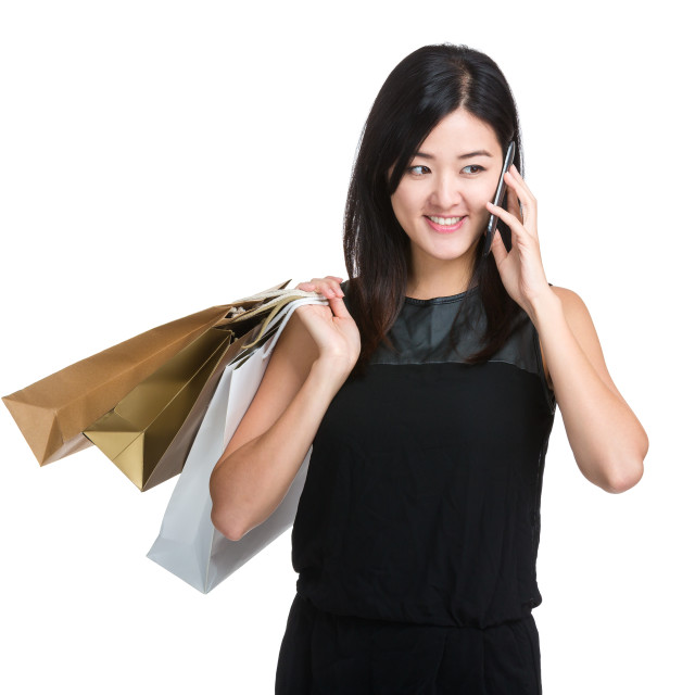 """Shopping woman with paper bag and mobile phone"" stock image"