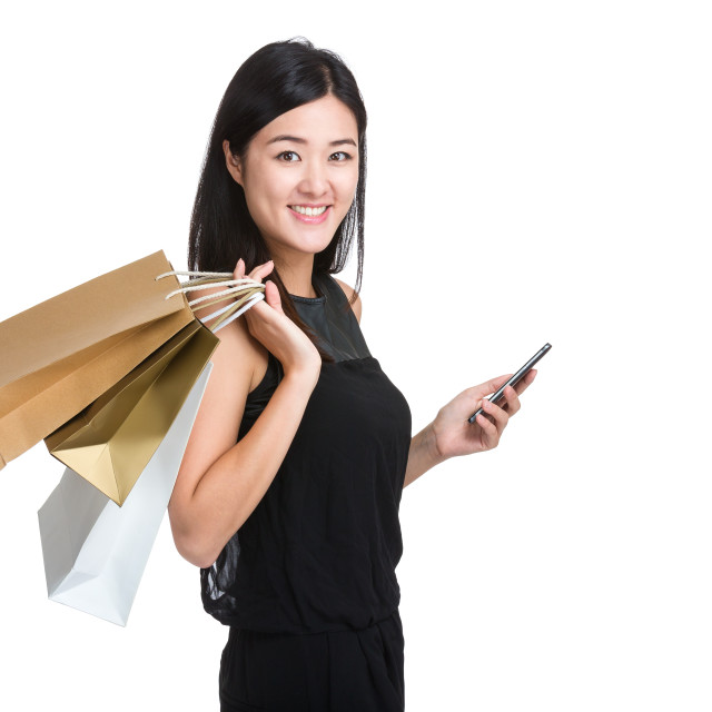 """Asian woman with shopping bag and mobile phone"" stock image"