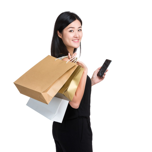 """Woman with shopping bag and mobile phone"" stock image"