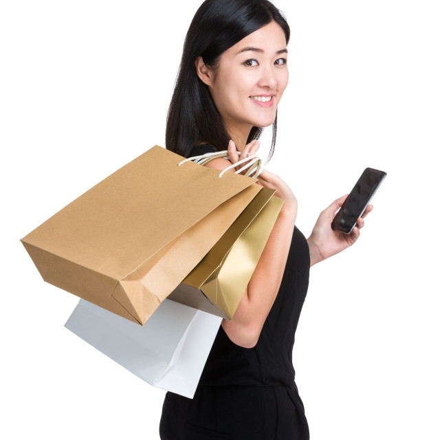 """Shopping girl hold mobile phone"" stock image"