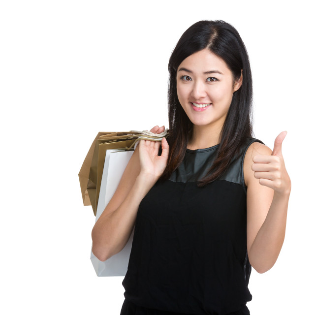 """Asian woman hold with shopping bag and thumb up"" stock image"