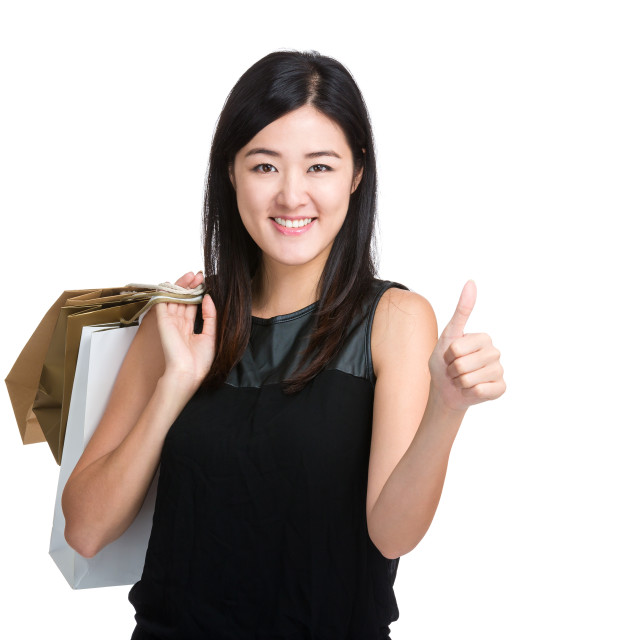 """Asian young woman thumb up with shopping bag"" stock image"