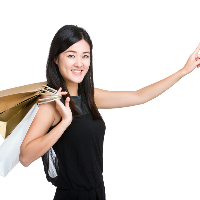 """Woman with shopping bag and hand point to direction"" stock image"