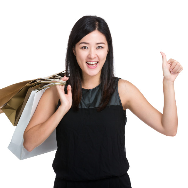 """Woman with shopping bag and thumb up"" stock image"