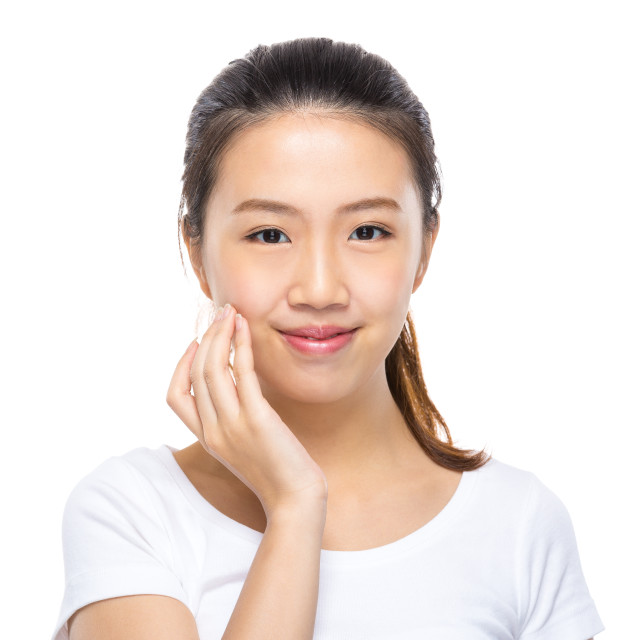 """""""Asian woman apply skincare on face"""" stock image"""