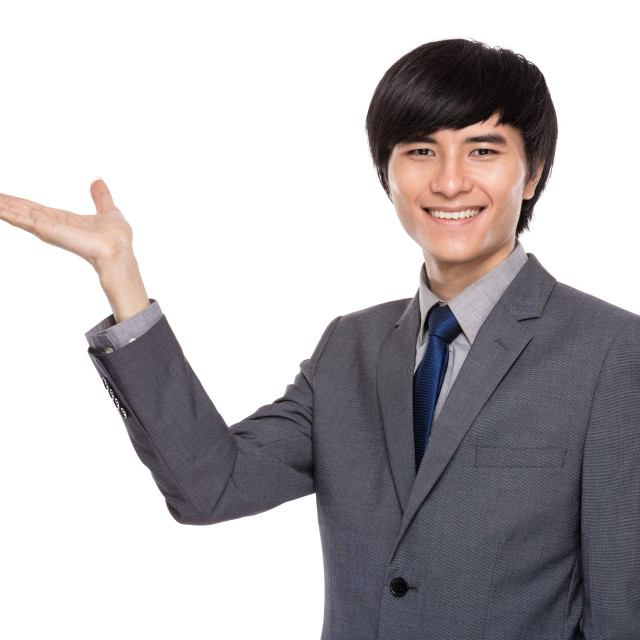 """""""Businessman with hand present"""" stock image"""