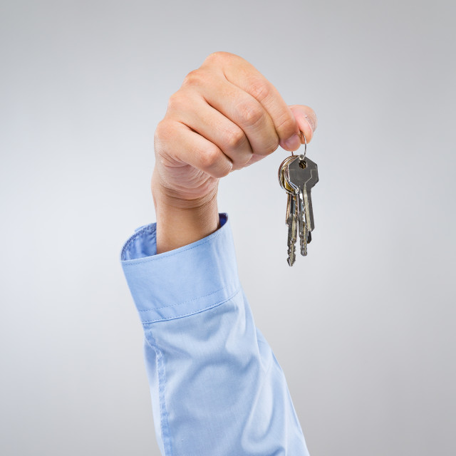 """Man hold with key chain"" stock image"