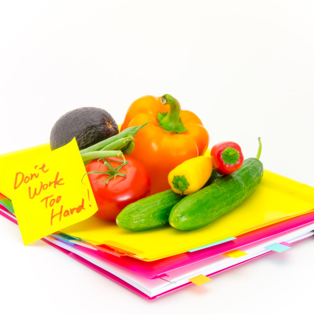 """Office Documents and Vegetables; Don't Work Too Hard"" stock image"