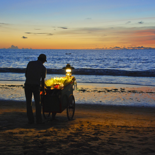"""Vendor of Corn at Jimbaran beach at sunset"" stock image"