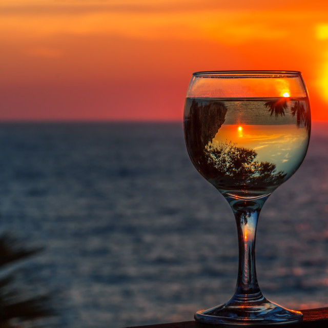 """white wine on the sunset sea background"" stock image"