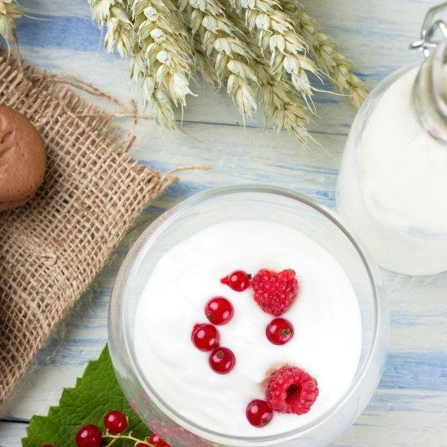 """""""Top view on white yogurt in a glass with berries"""" stock image"""
