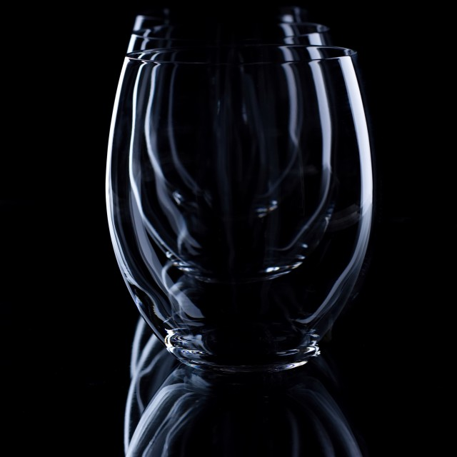 """""""Three oval glasses in a row on black board"""" stock image"""