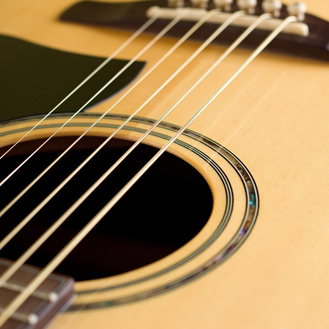 """Detail of front side of acoustic guitar"" stock image"