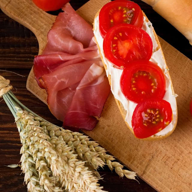 """""""Baguette among vegetable ham and grains"""" stock image"""