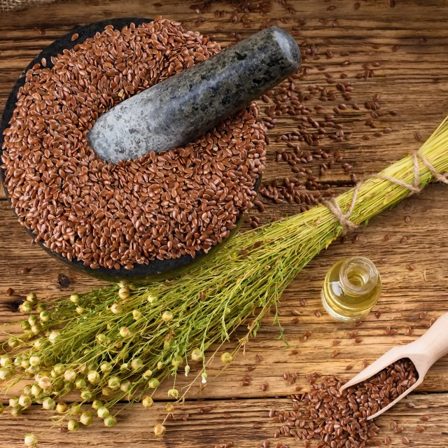 """""""Top view on board with flax seeds plants and oil"""" stock image"""