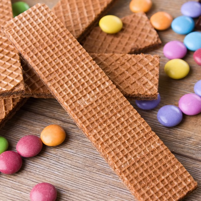"""Long biscuit with color chocolate sweets"" stock image"