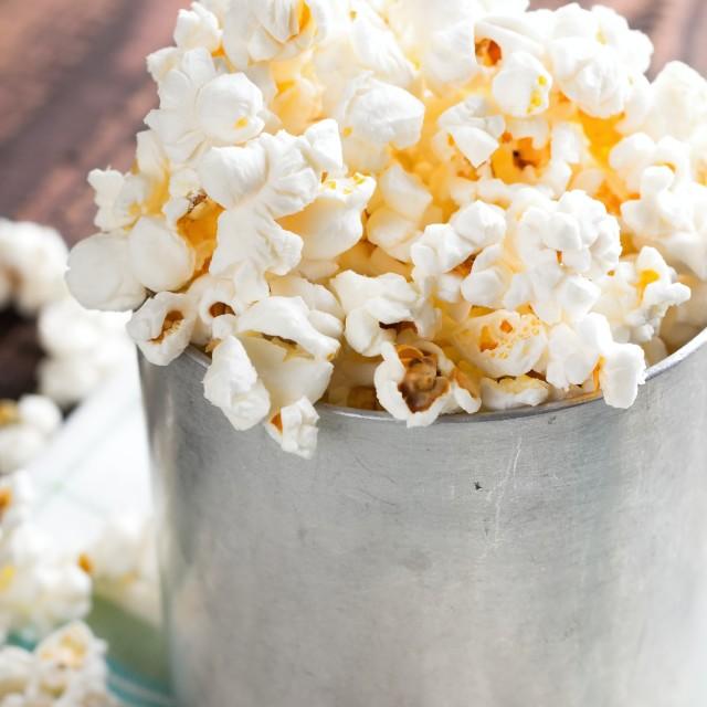 """""""Aluminum cup full of popcorn"""" stock image"""