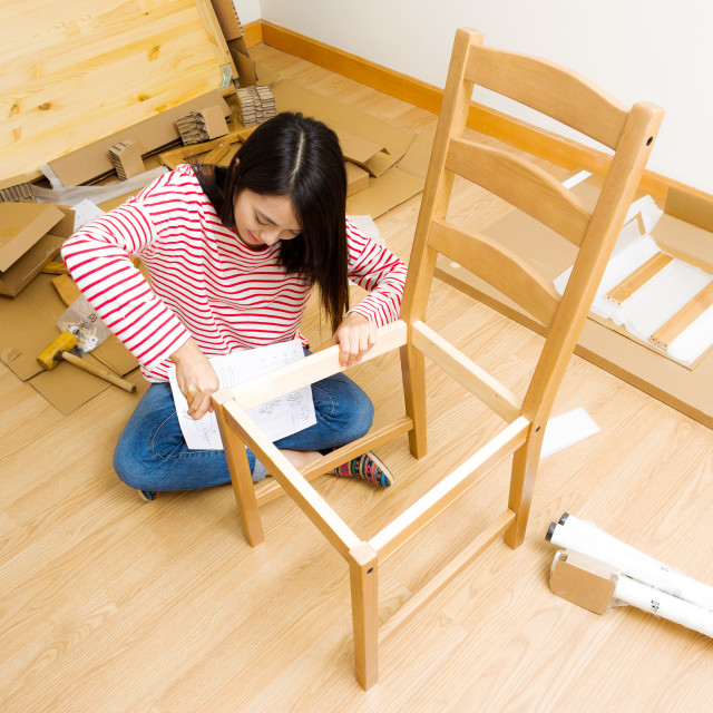 """Asian woman using strew driver for chiar assembling"" stock image"