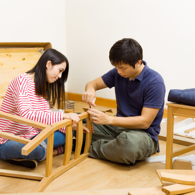 """Asian couple assembling chair"" stock image"