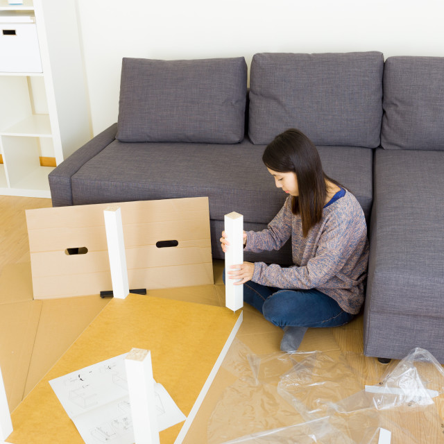 """Asian woman assembling table"" stock image"