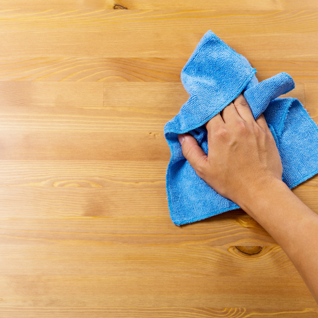"""Cleaning table by blue rag"" stock image"