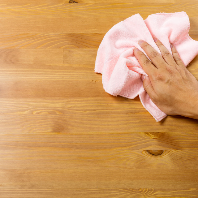 """Cleaning table by pink rag"" stock image"