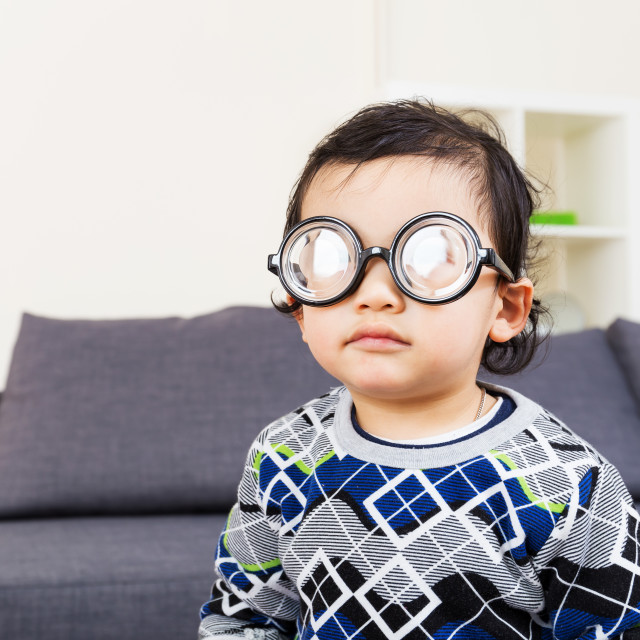 """""""Little baby boy wear thick glasses"""" stock image"""