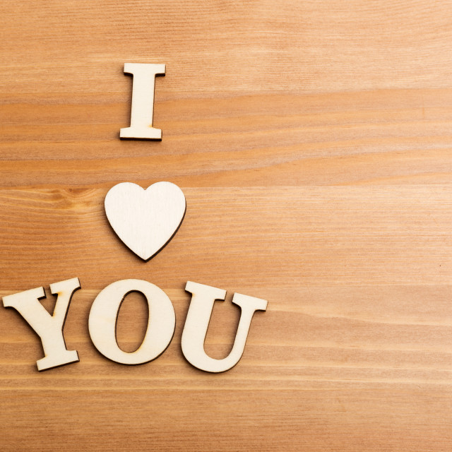 """""""Wooden letters forming with phrase I Love You and over the wooden background"""" stock image"""