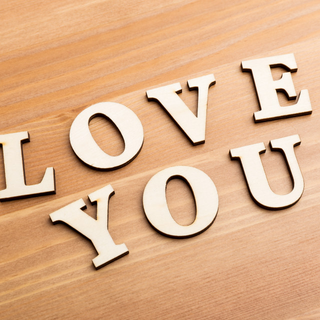 """""""Wooden texture letters forming with phrase Love You"""" stock image"""